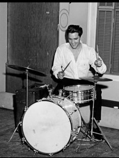 Elvis Presley playing the drums. I guess he really is the king of rock n'roll