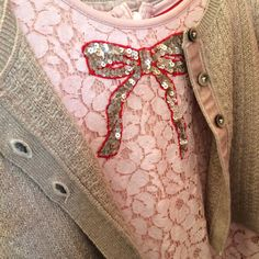 Sweet Gucci style glitter neckline bow on a lace pink dress at Mini Boden kids fashion for Holiday party 2017