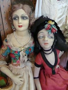 1920s boudoir doll- Most dolls feature either human hair, silk floss or mohair wigs, later dolls have synthetic hair. Most have painted features with bee stung lips and heavy eyeshadow, kohl rimmed eyes and a beauty mark. Some even sport false eyelashes made from human hair or camel hair. The very best dolls have glass eyes that sleep instead of just painted on.   -