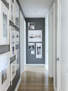Hallway decor ideas // white matted frames with black and white prints