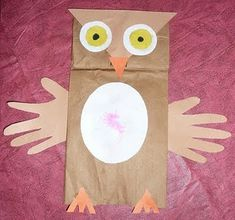 Make owl gift bags to fill with treats. Hand tracings for the wings make it extra personal.