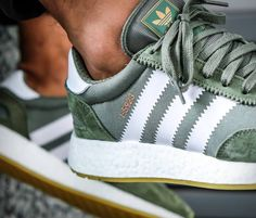 Rebranded as the Adidas after a life that began as the Iniki Runner, this new silhouette from the three stripes is introduced in a cool olive green iteration. The retro-fitted Boost sneaker fuses heritage lines with modern engineering, it feat Women's Shoes, Cute Shoes, Me Too Shoes, Shoe Boots, Shoes Sneakers, Shoe Bag, Mcqueen Sneakers, Green Sneakers, Golf Shoes