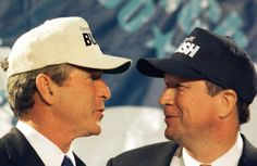 Texas Gov. George W. Bush (L) looks at U.S. Rep. John Kasich (R) after the Ohio Republican gave him the endorsement for the Republican nomination for president ending his campaign, July 14, 1999 in Washington. Kasich said he was endorsing Bush because his own campaign for the Oval Office came up short of both cash and public support. (Photo: Reuters)