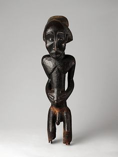 Commemorative figure Buli Master, possibly Ngongo ya Chintu (Hemba, ca. 1810-1870) Date: 19th century Geography: Democratic Republic of the Congo Culture: Hemba peoples Medium: Wood Dimensions: H. x W. x D.: 27 7/8 x 9 x 5 1/2 in. (70.8 x 22.9 x 14 cm) Classification: Wood-Sculpture Credit Line: Drs. Daniel and Marian Malcolm