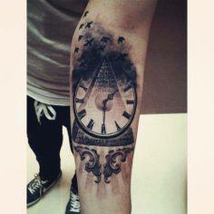Clock and pyramide tattoo