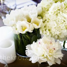 To achieve a clean look, white flowers like hydrangeas, tulips, and peonies were arranged separately in low-lying vases.