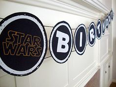 Star Wars birthday banner. I used the free printable, and it came out great! printed mine on cardstock through Office Depot online...my printer broke at the last moment.
