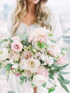 Overflowing dahlia, greenery and rose wedding bouquet: Photography: Tenth and Grace - http://www.tenthandgrace.com/