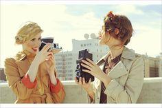 heidi plaits: check; cat-eye liner: check; vintage cameras: check; trench coats: check; poppy orange lips: check