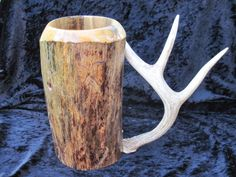 Use of the entire antler for this wooden beer stein. Beer mug, wooden mug, wood stein