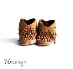 Bohemian fringe infant boots - these little booties would be a unique idea for a baby shower gift, and the brown is a cute unisex color. Could work for a girl or a boy. Love the these boho baby moccasin shoes!