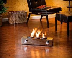 Sheer modern elegance wrapped up in a unique portable gel fireplace. Floating glass panels are held in place by a brushed nickel base that houses up to 3 cans of FireGlo gel fuel with output up to BTU each. Portable and great for indoor and outdoor use. Gel Fireplace, Fireplace Design, Small Fireplace, Bioethanol Fireplace, Fireplace Inserts, Fireplace Ideas, Fireplace Mantels, Portable Fireplace, Indoor Outdoor Fireplaces