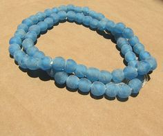 40 pieces small recycled glass beads from Ghana. Main colour is Blue Wholesale price Shipping time 2 weeks to customer Recycled Glass, Blue Beads, Main Colors, Ghana, Fair Trade, Turquoise Bracelet, Glass Beads, Buy And Sell, African