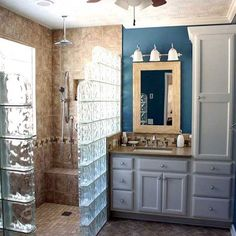 Love the glass bricks.. would be neat with lights in too.. also like the shower tile color