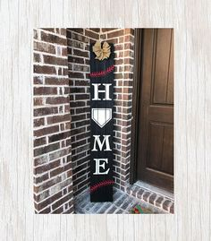 Show the world your love of the game with this unique baseball decor. This BLACK Home entryway sign features the shape of home plate and red baseball stitching in the design and is made from reclaimed wood fence pickets. You can choose your text color and ribbon from the drop down