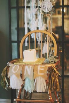 Highchair set-up for smash cake - love the layered banner! #firstbirthday #smashcake