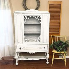 I just did this with chicken wire and I love it!!! This hutch cabinet has been given a new life with Snow White milk paint, waxed and distressed. #madenewdesign #lovewhatido #furnituremakeover #hutch #chinacabinet #farmhouse #home #decor