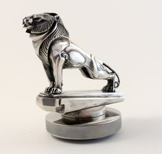 An exceptionally fine and extremely rare Deco proud Lion mascot, by G.Poitvin, French circa 1920/1925, silvered bronze, rare pure Art Deco design, Contenot/Lelievre foundry stamping on the base, one of the most elegant animal mascots, marketed by Hermes, the most prestigious shop in Paris in the twenties selling only the finest car mascots on the planet. Always keen to purchase more top mascots like this beauty I own. Tony 07973886937, tony@tvwglobal.com