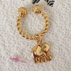 Lilly Pulitzer Elephant Key Ring Super cute gold tone elephant key ring with knot detail. New but the actual tag came off. Will ship as seen in the first 2 pics. Lilly Pulitzer Accessories Key & Card Holders