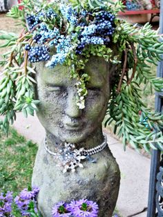 One of my most prized possessions (a gift to me from my son) – Originally adorned with faux pansies in her very long hair and currently dressed with vintage jewels around her neck and faux berries in a shorter do – which happens to be donkey tail !!!  It's pure love!!   Suzanne (Moss Female)