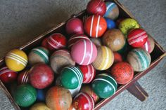 I never tire of looking at my colorful vintage croquet balls :)