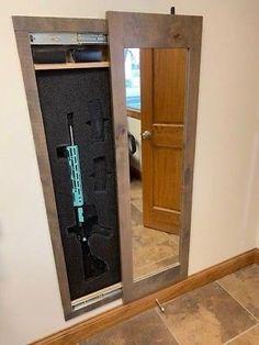 Hidden storage mirror In-wall gun safe concealment cabinet rifle pistol - gray In Wall Gun Safe, Gun Safe Room, Hidden Gun Safe, Hidden Gun Storage, Secret Storage, Safe Storage, Diy Storage, Gun Concealment Furniture, Hidden Gun Cabinets