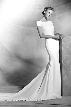 Simple crepe mermaid wedding dress with short sleeves. Bodice with bateau neckline and a large center back opening. Atelier Pronovias, 2016