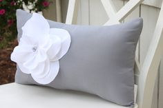 Shabby Chic Gray Pillow with Fraying White Flower and Pearl Accents. $23.50, via Etsy.