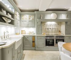 Exquisite Grey Painted Kitchen – Tom Howley (I like how the sink comes out, like the cabinet below, love the tap with the sprayer, like the skirt board