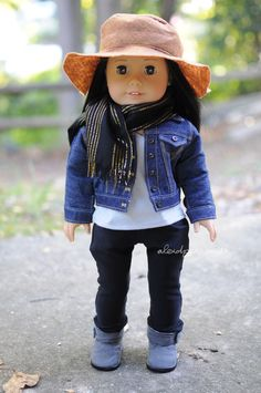 Tee by Sparrow and Wren, pants by Anick's Boutique, jean jacket by Rainbow Lily Designs, hat by Olivia and Atticus, scarf by Clarisse's Closet and boots are AG brand. American Girl
