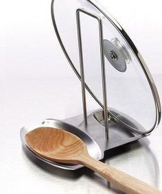 A place for the spoon and the lid (and it can catch the steam from the lid, too!)