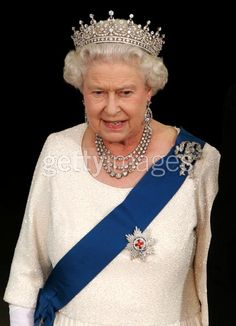 Diamond Festoon Necklace worn by HM Queen Elizabeth II along with the Girls of Great Britain Tiara and the Cambridge Lovers Knot Brooch