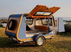 carapate adventure unveiled a yacht-inspired camper which rethinks the teardrop trailer with its trapezoid shape. The post boat-like trailer opens up to the world with oversized side entry appeared first on designboom Best Travel Trailers, Camper Trailers, Camper Van, Off Road Camper Trailer, Bike Trailer, Lightweight Campers, Marine Grade Plywood, Adventure Campers, Adventure Trailers
