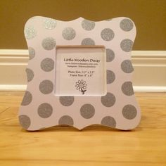 A personal favorite from my Etsy shop https://www.etsy.com/listing/254569236/sparkly-polka-dot-picture-frame-silver