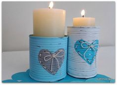 Punch holes in cans, paint, and lace up the holes to create cute candle holders for pillar candles