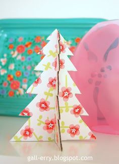 DIY Christmas tree made of cardboard and decorative paper. So easy!