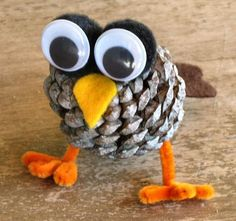 Pine Cone Owl using pipe cleaners, large googly eyes, felt and black pom poms
