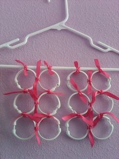 Tie shower curtain rings to a hanger and thread your scarves through them.