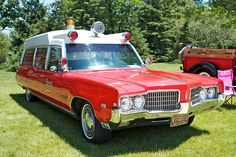 vintage 60s  Oldsmobile Olds red color Ambulance