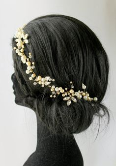 ❀ Tuppence Wedding Headdress ❀  A modern pearl cluster style vine with glittering diamante leave detail. Mounted onto a strong yet very flexible wire base. Fastens with either hair pins or a pretty ribbon via a small loop on either end.   ~ Measurements: 5.5 cm at widest point. ~ Length: Half Halo 22 cm = £70.73 3/4 Halo 36 cm = £79.23 Full Halo 55 cm = £87.73 ~ Wiring: Silver, Gold or Rose - Gold. ~ Colour Pallet: White, Ivory & Cream.  ~ All of my beautiful bridal a...