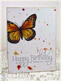 I then masked both the butterfly and the sentiment and literally flung orange and gold paint at the card.  My last step was to use gold ink ...