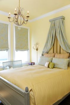 A bright and warm bedroom gets a feeling of sunshine from the butter yellow bedspread, and walls and ceiling painted sunny yellow with white trim.  (via Brian Dittmar Design, Inc.)