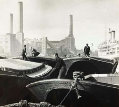 Deptford Creek Workers at Deptford Creek picking up empty barges to take to Victoria Dock to be loaded with wheat. Three of the boat's names are visible: 'Bristol', 'London Pride' and 'Madrid'. Deptford power station is in the East End London, South London, Old London, Bristol London, London Docklands, London Pride, Boat Names, River Thames, Historical Pictures