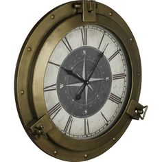 Evoking mariners' compasses, this bronze-finished wall clock brings a splash of nautical style to your walls.  Product: Wall clo...