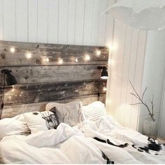 Adore this Wood Headboard and Fairy lights. A natural and simple romantic bedroom idea.