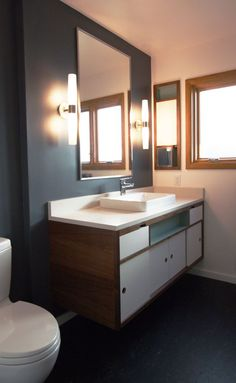 portland mid century modern bathroom remodel with two toned cabinets i especially appreciate the shallow teal painted cubby in front of the sink bathroom lights mid century