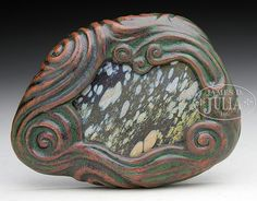 TIFFANY STUDIOS BRONZE AND FAVRILE GLASS PAPERWEIGHT.