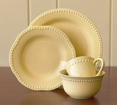 Emma Dinnerware-Yellow #potterybarn   Love these plates,would love them better if they were square.....