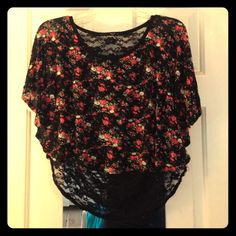 Flowered High-Low Lace Crop Top High-low crop top with Black lace back. Beautiful flower design on front. Size large. Love J, U.S.A Tops Crop Tops