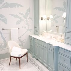 iPhone photo of a recent master bedroom bathroom oasis! This bathroom has a custom painted mural by a local artists to compliment the floor tile design. #mccanndesigngroup #palmbeach #palmbeachfl #masterbath #masterbathroom #seafoam #whitebathroom #interiordesign #interiors